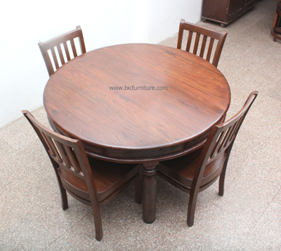 Round_large_wooden_dining_table_4_seater